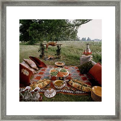 Robert Carrier's Moroccan Picnic In A Field Framed Print
