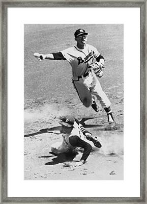 Roberto Clemente Sliding Framed Print by Underwood Archives