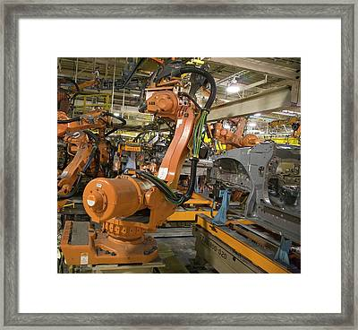 Robot On Car Assembly Production Line Framed Print by Jim West