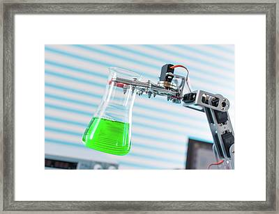 Robotic Arm Holding Chemical Flask Framed Print by Wladimir Bulgar