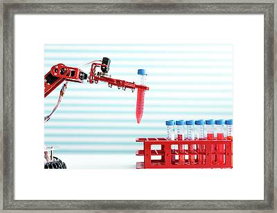 Robotic Arm Holding Test Tube Framed Print by Wladimir Bulgar