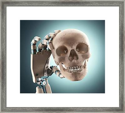 Robotic Hand Holding A Human Skull Framed Print