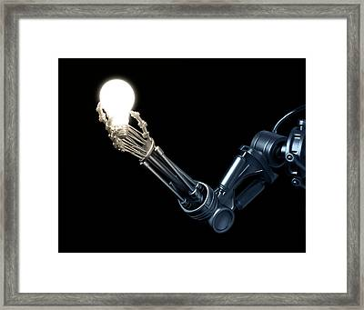 Robotic Hand Holding A Lightbulb Framed Print by Andrzej Wojcicki