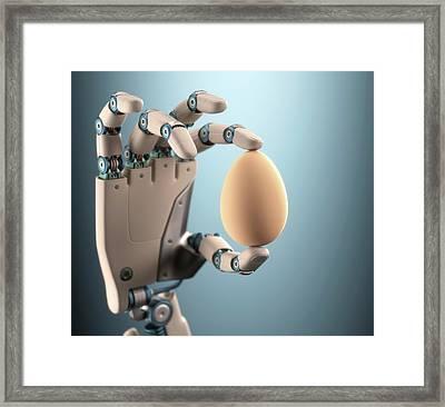 Robotic Hand Holding Egg Framed Print