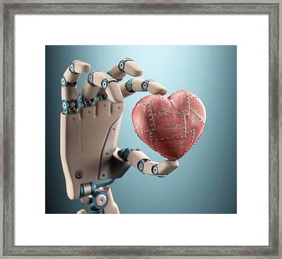 Robotic Hand Holding Heart Framed Print by Ktsdesign