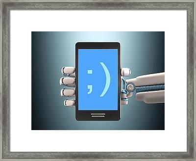 Robotic Hand Holding Phone Framed Print by Ktsdesign