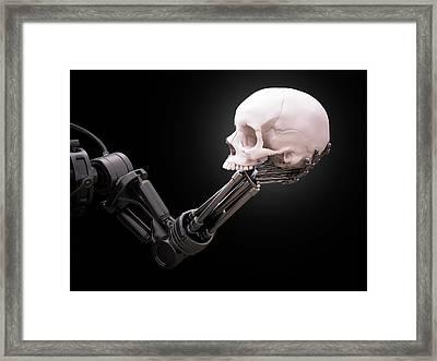 Robotic Hand Holding Skull Framed Print