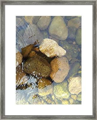 Rock And Pebbles Framed Print by David Stribbling