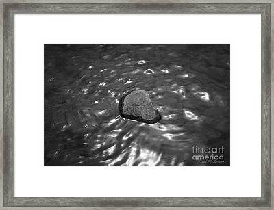 Rock And Sun Reflections Framed Print by Dave Gordon