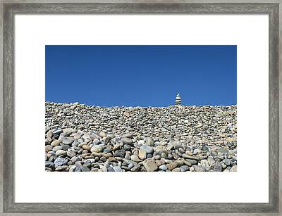 Rock Cairn On Stonewall Beach Framed Print by John Greim