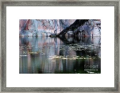 Rock Cliff And Reflections Framed Print by Charline Xia