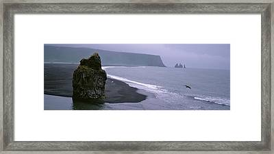 Rock Formation On The Beach Framed Print by Panoramic Images