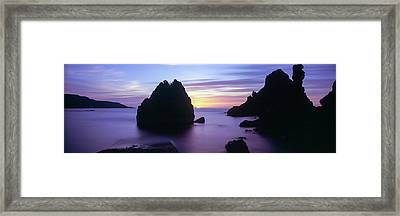 Rock Formations In The Sea At Sunset Framed Print by Panoramic Images