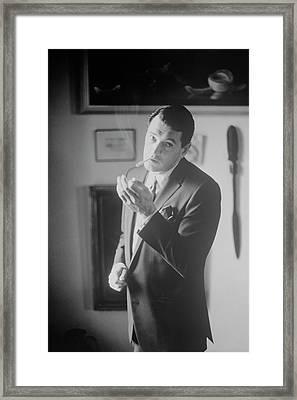 Rock Hudson Lighting A Cigarette Framed Print by John Bryson