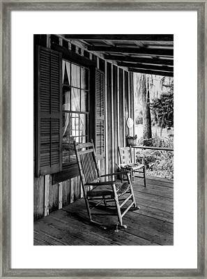 Rocker On The Veranda Framed Print by Lynn Palmer
