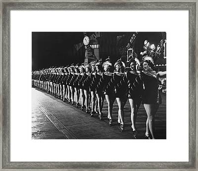 Rockettes Brighten Up Manhattan Streets Framed Print by Retro Images Archive