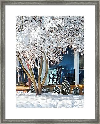 Rocking Chair On Porch In Winter Framed Print