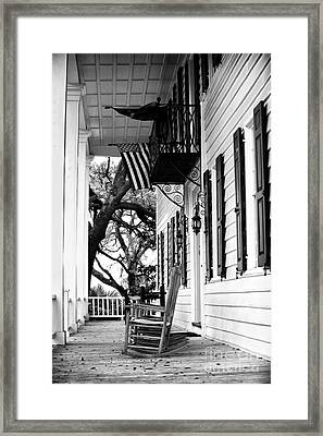 Rocking Chair On The Porch Framed Print by John Rizzuto