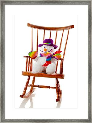Framed Print featuring the photograph Happy Snowman Sitting In A Rocking Chair  by Vizual Studio