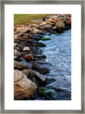 Rocks Along River Framed Print by Victoria Clark