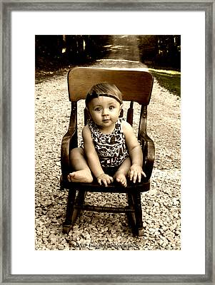 Rocks And Chair Framed Print