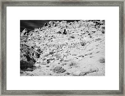 Rocks Forming Support For The Old Arrowhead Trail Road Valley Of Fire State Park Nevada Usa Framed Print by Joe Fox