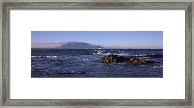 Rocks In The Sea With Table Mountain Framed Print by Panoramic Images