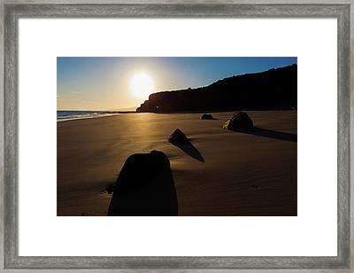 Rocks On Sandy Beach At Sunset Framed Print by Wladimir Bulgar