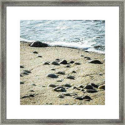 Rocks Sand And Sea Framed Print by Dawn Romine