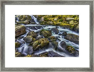 Rocky Ice Water Framed Print by Ian Mitchell