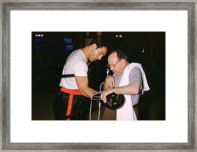 Rocky Marciano Looking At Glove Framed Print by Retro Images Archive