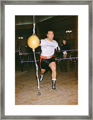 Rocky Marciano Striking Bag Framed Print