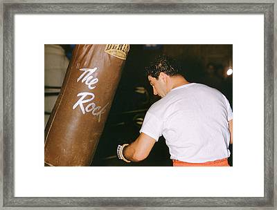 Rocky Marciano Vs. Heavy Bag Framed Print by Retro Images Archive