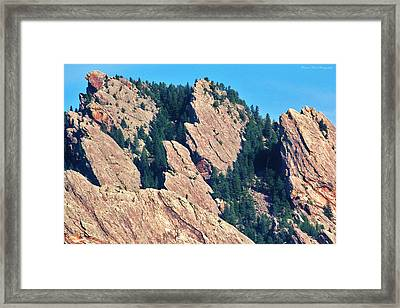Rocky Mountain Towers Framed Print by David Broome