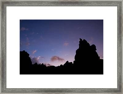Rocky Purple Sunset Framed Print by Charmian Vistaunet