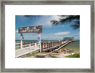 Rod And Reel Pier Framed Print by Geraldine Alexander
