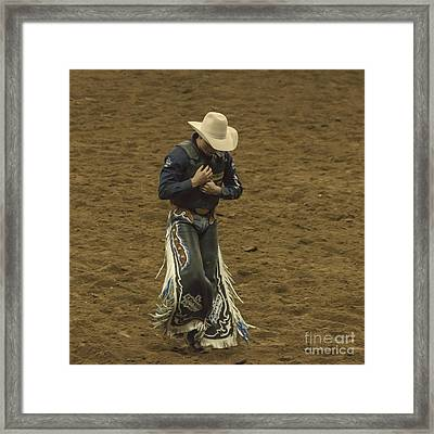 Rodeo Cowboy Dusting Off Framed Print by Janice Rae Pariza
