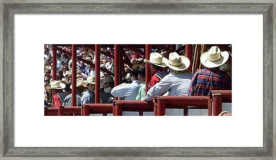 Rodeo Time Cowboys Framed Print by Susan Garren