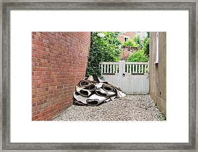 Rolled Carpets Framed Print by Tom Gowanlock