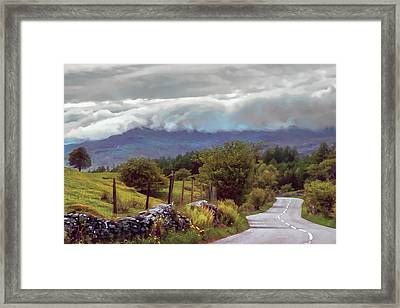 Rolling Storm Clouds Down Cumbrian Hills Framed Print
