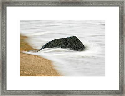 Surf Caresses A Lonely Stone Framed Print