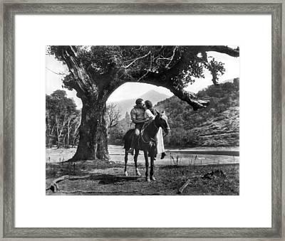 Romantic Kiss On Horseback Framed Print by Underwood Archives
