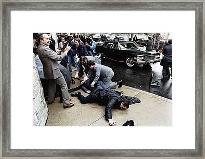 Ronald Reagan. A Secret Service Agent Framed Print by Everett