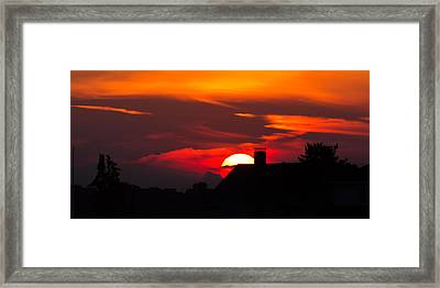 Rooftop Sunset Silhouette Framed Print