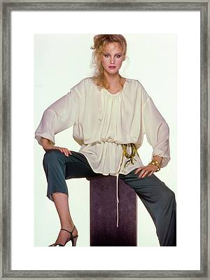 Rosie Vela Sitting On A Pedestal Wearing A White Framed Print