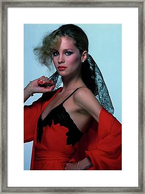 Rosie Vela Wearing A Red Camisole Framed Print by Albert Watson