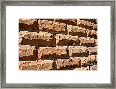 Rough Hewn Sandstone Brick Wall Of A Historic Building In Salt Lake City Framed Print by Gary Whitton