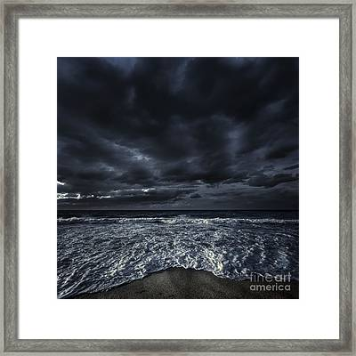 Rough Seaside Against Stormy Clouds Framed Print by Evgeny Kuklev