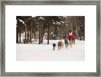 Rounding A Corner Framed Print by Tim Grams
