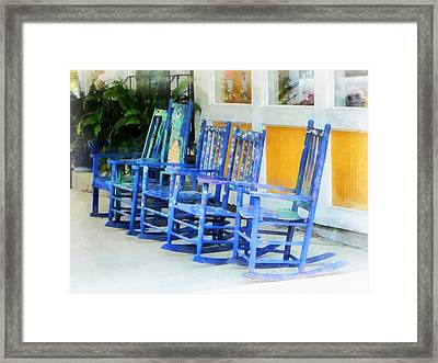 Row Of Blue Rocking Chairs Framed Print by Susan Savad
